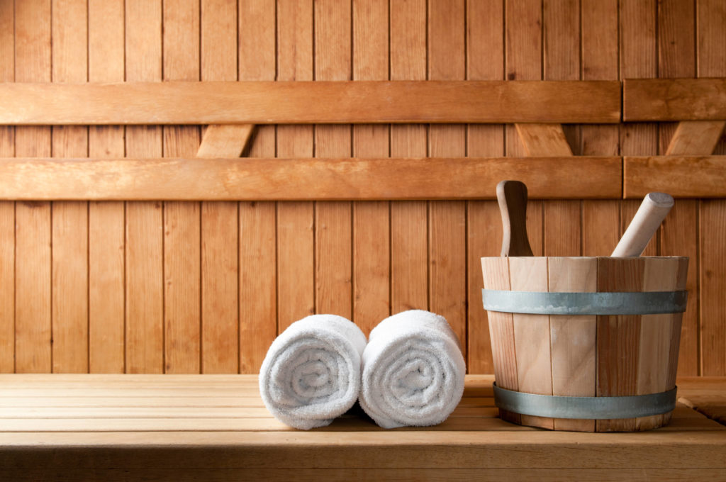 bucket and white towels in sauna