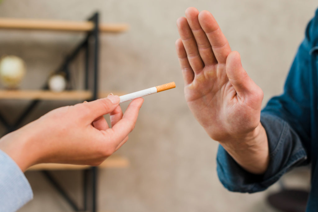 man refusing a cigarette