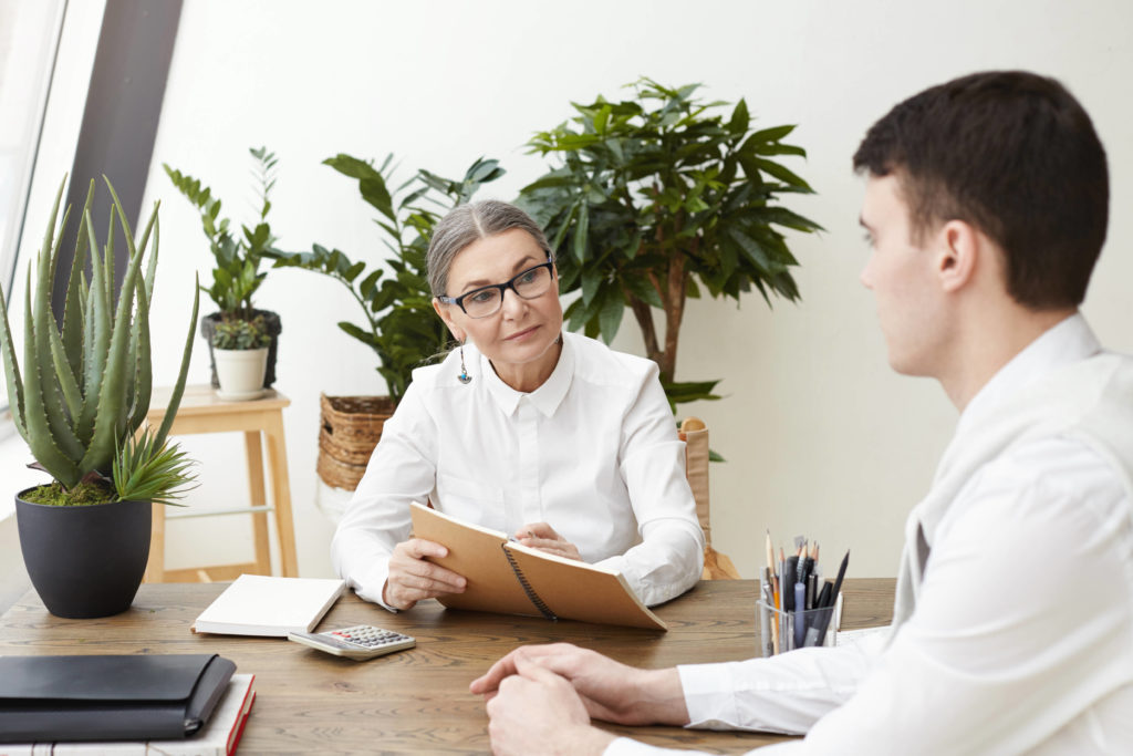 woman interviewing a young man