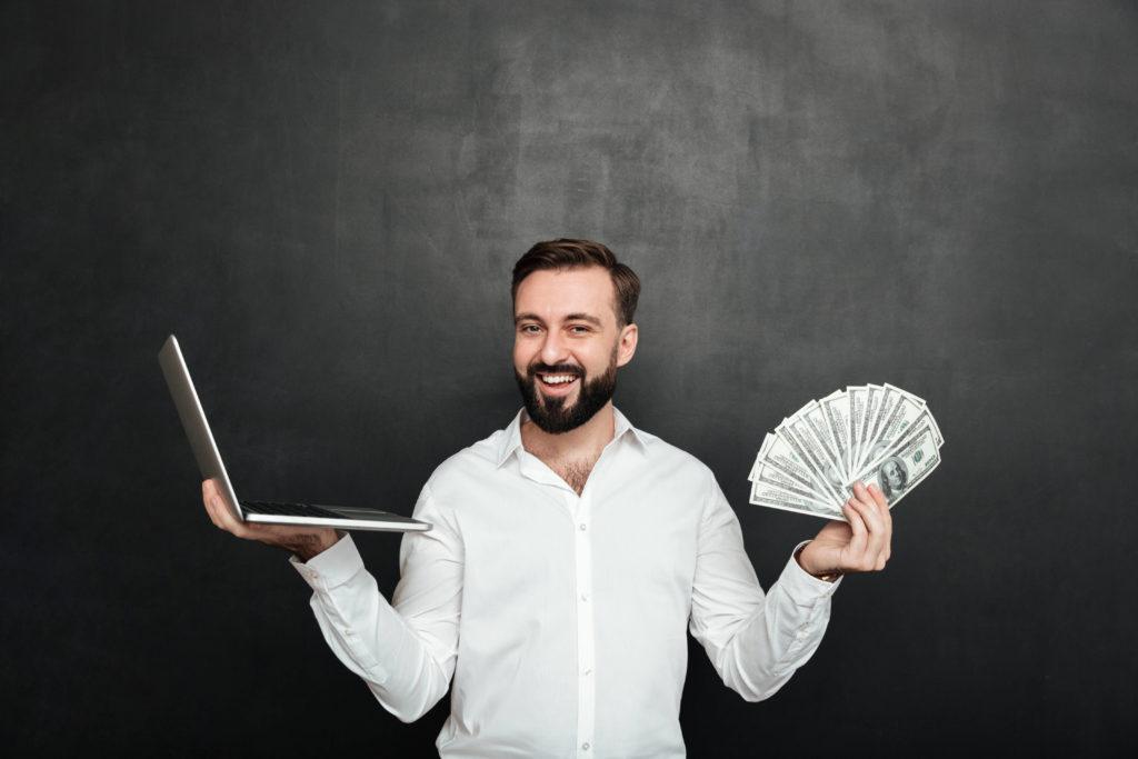 portait of cheerful man holding rahaa