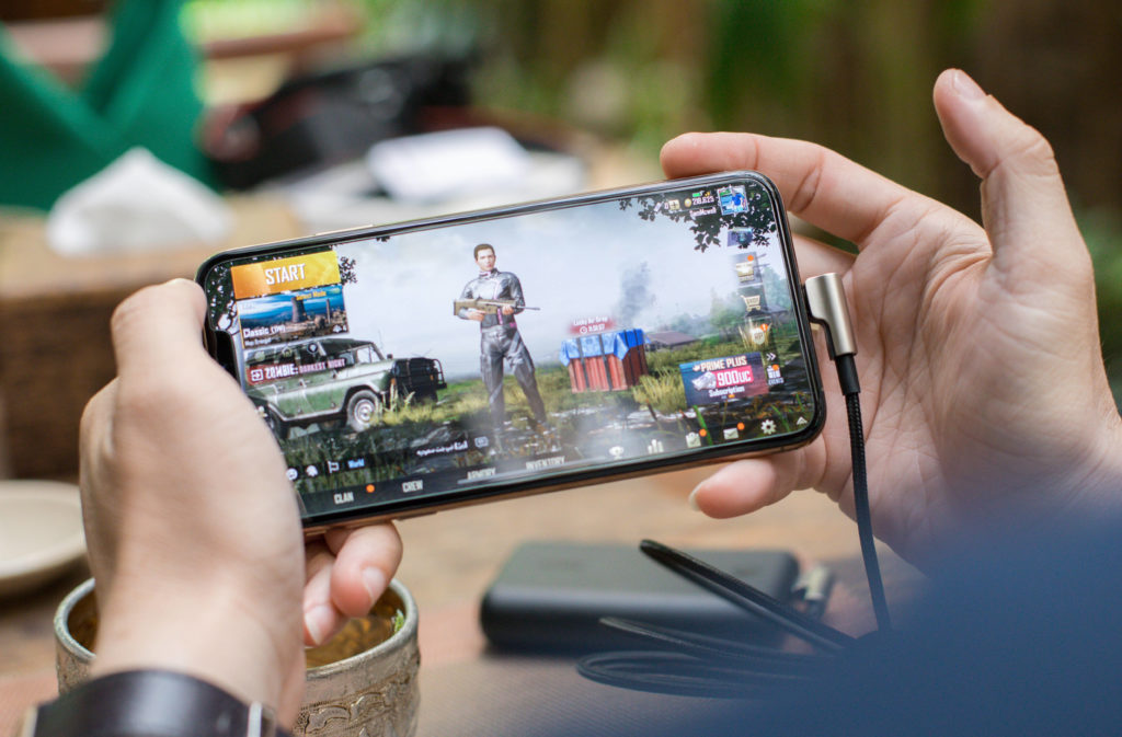 person playing PUBG on a phone