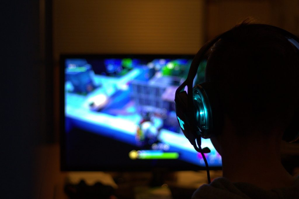 person playing Fortnite, blurred