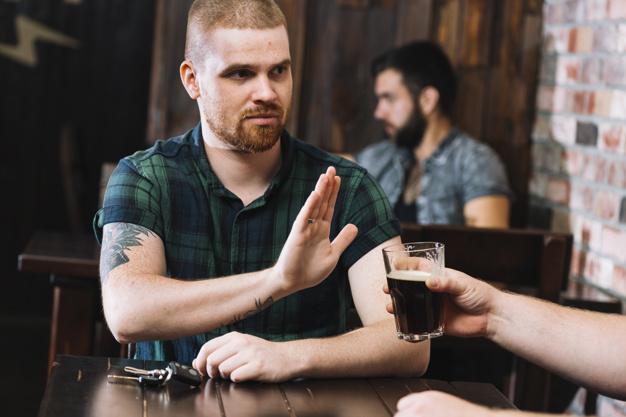 man refusing alcohol
