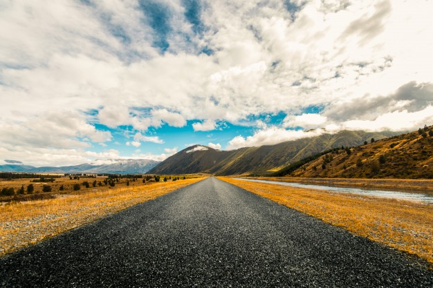 Long road with mountains