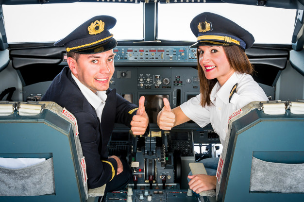 young pilots posing in a flight simulator